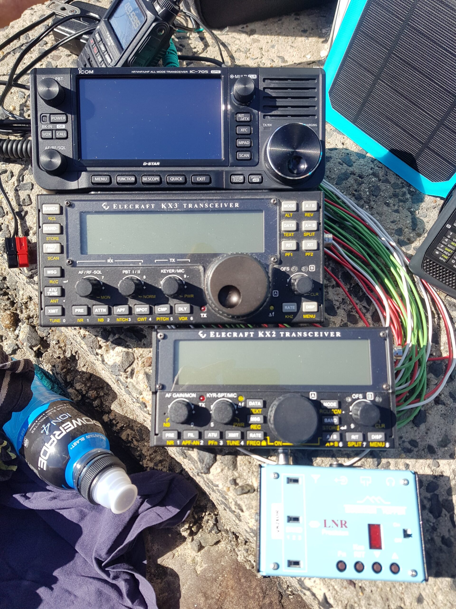 Photo of 4 portable HF rigs: IC-705, KX3, KX2, MTR3B